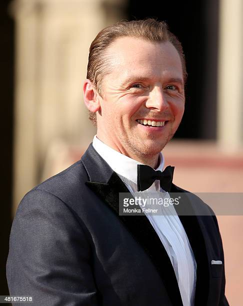 Simon Pegg smiles on stage during the world premiere of 'Mission Impossible Rogue Nation' at the Opera House on July 23 2015 in Vienna Austria