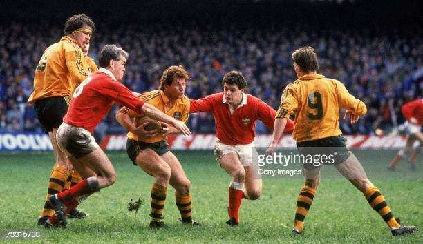 Simon Poidevin of the Wallabies is tackled during a Rugby Union test match between Wales and the Australian Wallabies at the Millennium Stadium in...
