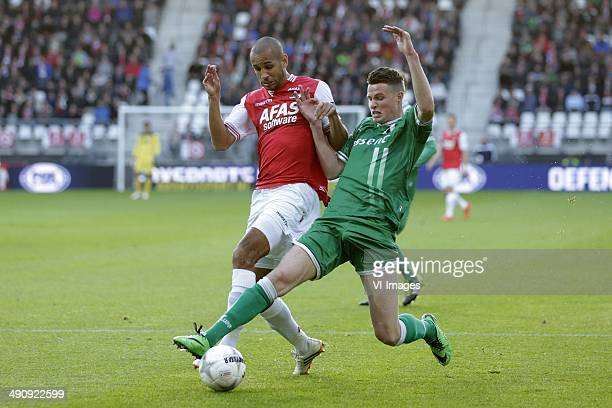 Simon Poulsen of AZ Hans Hateboer of FC Groningen during the EL playoff Final match between FC Groningen and AZ Alkmaar at Euroborg on May 18 2014 in...
