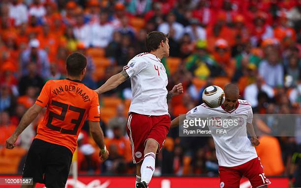 Simon Poulsen of Denmark heads the ball and hits the back of his team mate Daniel Agger scoring an own goal during the 2010 FIFA World Cup Group E...