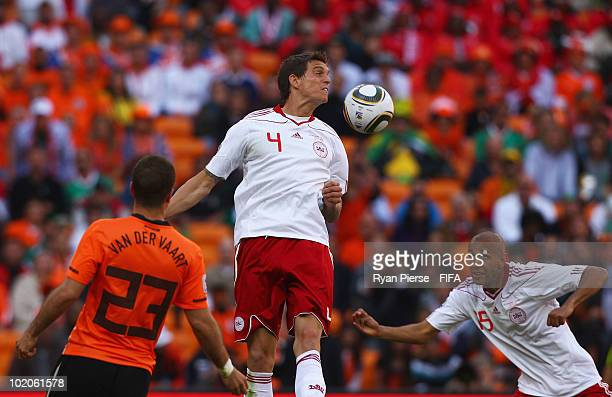 Simon Poulsen of Denmark heads the ball and hitting the back of his team mate Daniel Agger and scores an own goal during the 2010 FIFA World Cup...