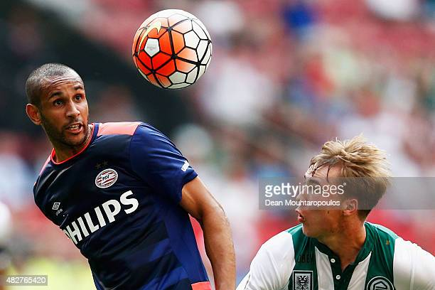 Simon Poulsen of PSV battles for the ball with Simon Tibbling of Groningen during the Johan Cruijff Shield match between FC Groningen and PSV...