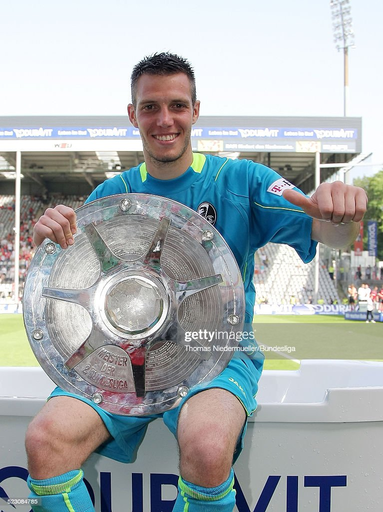 <a gi-track='captionPersonalityLinkClicked' href=/galleries/search?phrase=Simon+Pouplin&family=editorial&specificpeople=2087398 ng-click='$event.stopPropagation()'>Simon Pouplin</a> of Freiburg presents the trophy for the second Bundesliga champion after the second Bundesliga match between SC Freiburg and 1. FC Kaiserslautern at the badenova stadium on May 24, 2009 in Freiburg im Breisgau, Germany.
