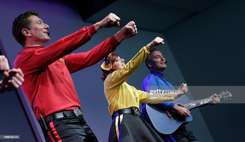 Simon Pryce, Emma Watkins and Lachlan Gillespie of the Wiggles perform at the at Apple Store Soho on May 12, 2013 in New York City.