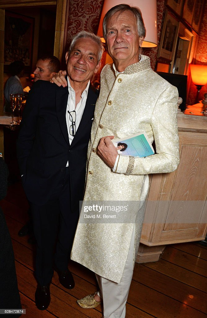 Simon Reubens (L) and Charles Delevingne attend the launch of Dame Joan Collins' new book 'The St. Tropez Lonely Hearts Club' at Harry's Bar on May 5, 2016 in London, England.