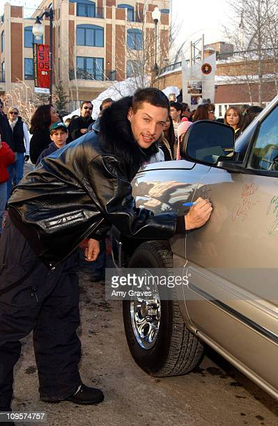 Simon Rex autographs a 2005 Chevrolet Silverado Pickup which General Motors will donate to the National Ability Center a local charity organization