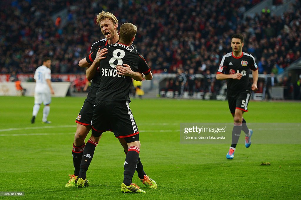 <a gi-track='captionPersonalityLinkClicked' href=/galleries/search?phrase=Simon+Rolfes&family=editorial&specificpeople=635100 ng-click='$event.stopPropagation()'>Simon Rolfes</a> of Bayer Leverkusen celebrates with team mate <a gi-track='captionPersonalityLinkClicked' href=/galleries/search?phrase=Lars+Bender&family=editorial&specificpeople=644948 ng-click='$event.stopPropagation()'>Lars Bender</a> after scoring his team's second goal during the Bundesliga match between Bayer Leverkusen and 1899 Hoffenheim at BayArena on March 23, 2014 in Leverkusen, Germany.