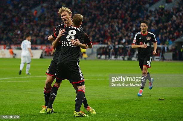 Simon Rolfes of Bayer Leverkusen celebrates with team mate Lars Bender after scoring his team's second goal during the Bundesliga match between Bayer...