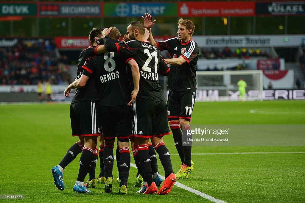 Simon Rolfes of Bayer Leverkusen celebrates with team mates after scoring his team's second goal during the Bundesliga match between Bayer Leverkusen...
