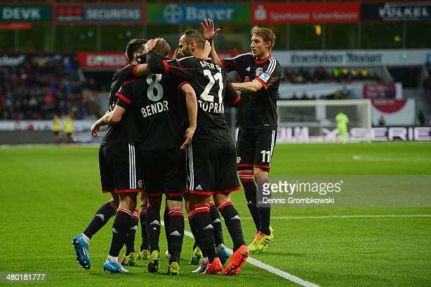 Simon Rolfes of Bayer Leverkusen celebrates with team mates after scoring his team's second goal during the Bundesliga match between Bayer Leverkusen...