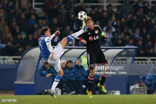 Simon Rolfes of Bayer Leverkusen duels for the ball with Gorka Elustondo of Real Sociedad during the UEFA Champions league football match between...