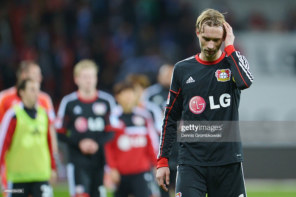 <a gi-track='captionPersonalityLinkClicked' href=/galleries/search?phrase=Simon+Rolfes&family=editorial&specificpeople=635100 ng-click='$event.stopPropagation()'>Simon Rolfes</a> of Bayer Leverkusen looks dejected after the Bundesliga match between Bayer Leverkusen and FC Schalke 04 at BayArena on February 15, 2014 in Leverkusen, Germany.