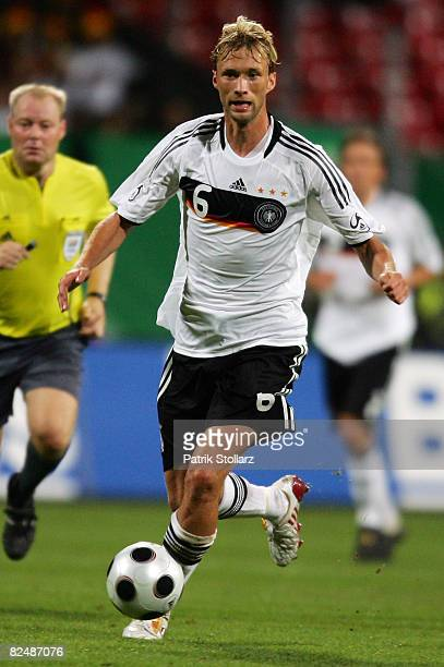 Simon Rolfes of Germany runs with the ball during the international friendly match between Germany and Belgium at the easyCredit stadium on August 20...
