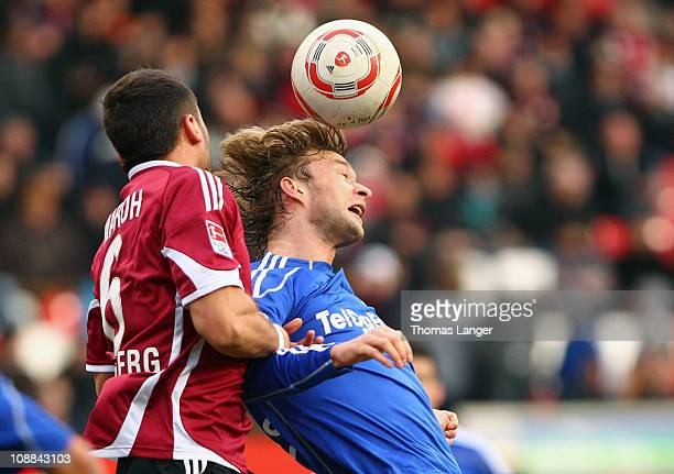 Simon Rolfes of Leverkusen and Dominic Marohof Nuernberg battle for the ball during the Bundesliga match between 1 FC Nuernberg and Bayer Leverkusen...