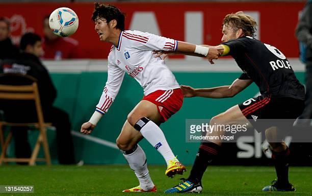 Simon Rolfes of Leverkusen and HeungMin Son of Hamburg battle for the ball during the Bundesliga match between Bayer 04 Leverkusen and Hamburger SV...