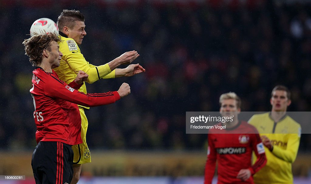 Simon Rolfes of Leverkusen and Lukasz Piszczek of Dortmund battle for the ball during the Bundesliga match between Bayer 04 Leverkusen and Borussia Dortmund at BayArena on February 3, 2013 in Leverkusen, Germany.