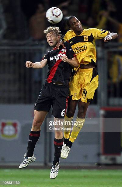 Simon Rolfes of Leverkusen and Ricardo Faty of Aris Thessaloniki go up for a header during the UEFA Europa League Group B match between Bayer...
