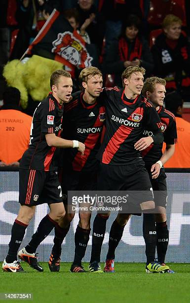 Simon Rolfes of Leverkusen celebrates with teammates Michal Kadlec Stefan Kiessling and Andre Schuerrle after scoring his team's second goal during...