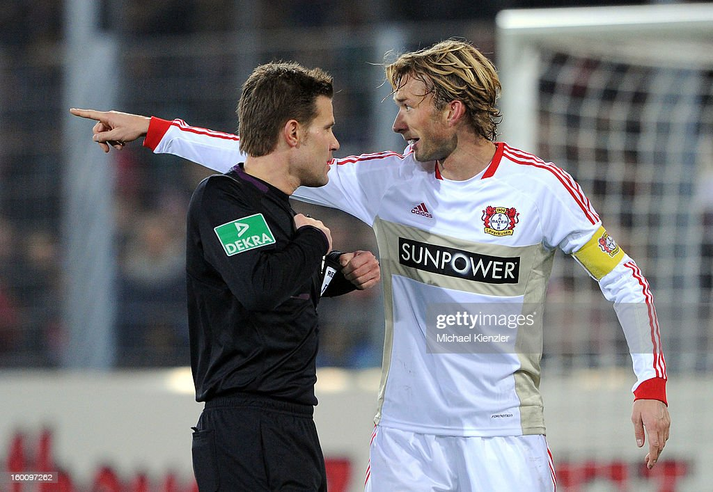 <a gi-track='captionPersonalityLinkClicked' href=/galleries/search?phrase=Simon+Rolfes&family=editorial&specificpeople=635100 ng-click='$event.stopPropagation()'>Simon Rolfes</a> of Leverkusen (R) discussing with referee <a gi-track='captionPersonalityLinkClicked' href=/galleries/search?phrase=Felix+Brych&family=editorial&specificpeople=707645 ng-click='$event.stopPropagation()'>Felix Brych</a> during the Bundesliga match between SC Freiburg and Bayer 04 Leverkusen at MAGE SOLAR Stadium on January 26, 2013 in Freiburg, Germany.