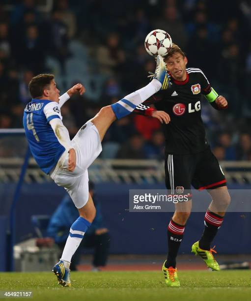 Simon Rolfes of Leverkusen is challenged by Gorka Elustondo of Real Sociedad during the UEFA Champions League Group A match between Real Sociedad de...