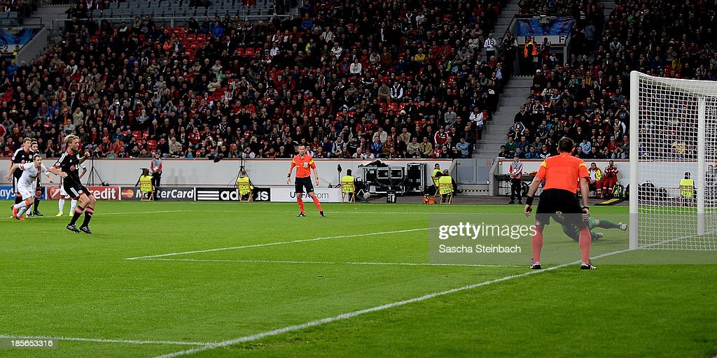 Simon Rolfes (L) of Leverkusen scores his team's second goal by a penalty during the UEFA Champions League Group A match between Bayer Leverkusen and Shakhtar Donetsk at BayArena on October 23, 2013 in Leverkusen, Germany.
