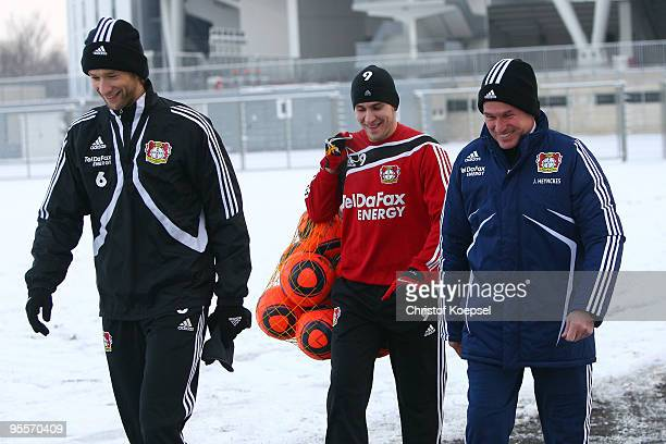 Simon Rolfes Patrick Helmes and head coach Jupp Heynckes of Bayer Leverkusen walk to their the training session at the training ground of Beyer...