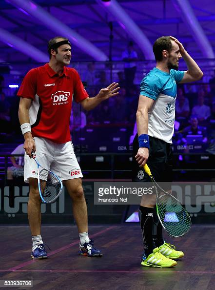 Simon Rosner of Germany apologise to Gregory Gaultier of France during day one of the PSA Dubai World Series Finals 2016 at Burj Park on May 24 2016...