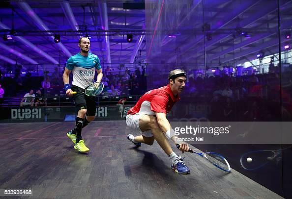 Simon Rosner of Germany competes against Gregory Gaultier of France during day one of the PSA Dubai World Series Finals 2016 at Burj Park on May 24...