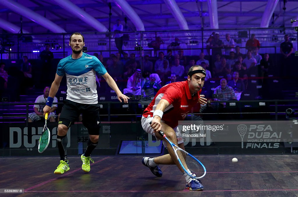 Simon Rosner of Germany competes against Gregory Gaultier of France during day one of the PSA Dubai World Series Finals 2016 at Burj Park on May 24, 2016 in Dubai, United Arab Emirates.
