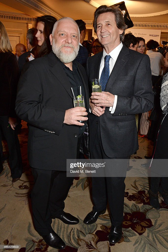 Simon Russell Beale (L) and Lord Melvyn Bragg attend a drinks reception at the South Bank Sky Arts awards at the Dorchester Hotel on January 27, 2014 in London, England.