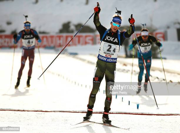Simon Schempp of Germany celebrates winning gold over Martin Fourcade of France and Anton Shipulin of Russia the Mixed Relay competition of the IBU...