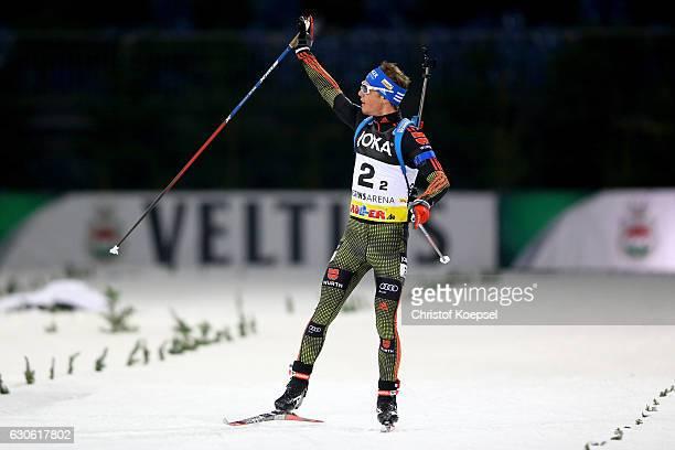 Simon Schempp of Germany celebrates winning the JOKA Biathlon World Team Challenge 2016 at VeltinsArena on December 28 2016 in Gelsenkirchen Germany