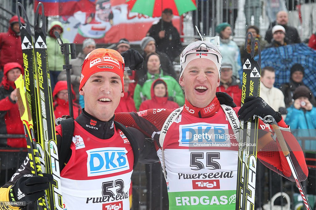 Simon Schempp of Germany celebrates with race winner <a gi-track='captionPersonalityLinkClicked' href=/galleries/search?phrase=Tarjei+Boe&family=editorial&specificpeople=6614833 ng-click='$event.stopPropagation()'>Tarjei Boe</a> of Norway after the men's 10km sprint during the IBU Biathlon World Cup on December 15, 2011 in Hochfilzen, Austria.