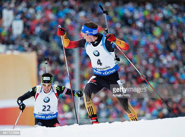 Simon Schempp of Germany checks over his shoulder to see Quentin Fillon Maillet of France during the IBU Biathlon World Cup Men's Mass Start on...