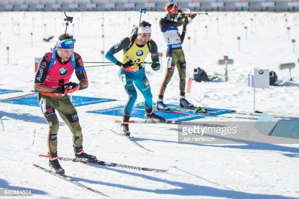 Simon Schempp of Germany Martin Fourcade of France and Benedict Doll of Germany in action during the men's 15km mass start competition of the the IBU...