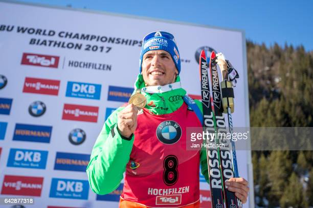 Simon Schempp of Germany poses for a picture during the victory ceremony of the men's 15km mass start competition during the IBU World Championships...
