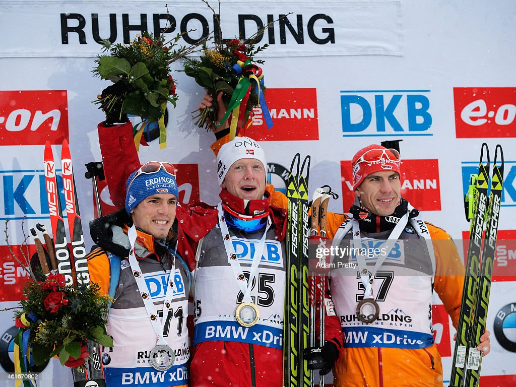 Simon Schempp of Germany second place, Johannes Thingnes Boe of Norway first place and Arnd Peiffer of Germany third place celebrate on the podium after the IBU Biathlon World Cup Men's Sprint on January 17, 2015 in Ruhpolding, Germany.