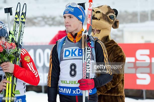 Simon Schempp on the podium during the IBU Biathlon World Cup 2014 race on Pokljuka