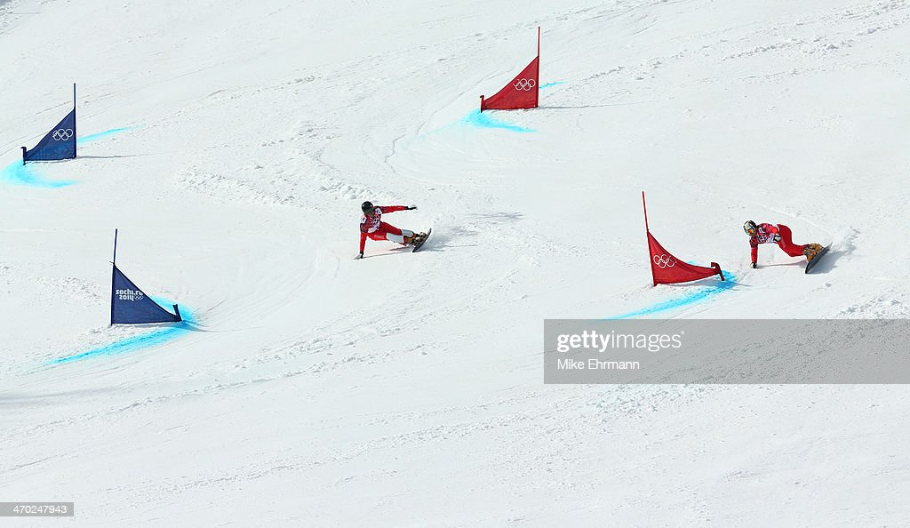 <a gi-track='captionPersonalityLinkClicked' href=/galleries/search?phrase=Simon+Schoch&family=editorial&specificpeople=869279 ng-click='$event.stopPropagation()'>Simon Schoch</a> of Switzerland (L) and Kaspar Fluetsch of Switzerland compete in the Snowboard Men's Parallel Giant Slalom 1/8 finals on day twelve of the 2014 Winter Olympics at Rosa Khutor Extreme Park on February 19, 2014 in Sochi, Russia.