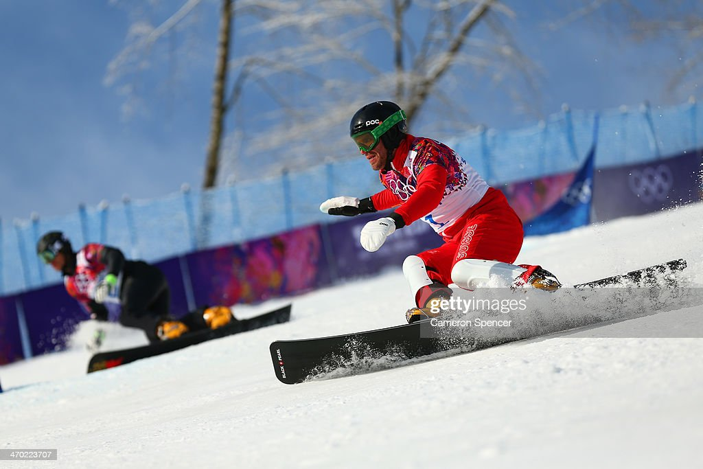 <a gi-track='captionPersonalityLinkClicked' href=/galleries/search?phrase=Simon+Schoch&family=editorial&specificpeople=869279 ng-click='$event.stopPropagation()'>Simon Schoch</a> of Switzerland (R) and <a gi-track='captionPersonalityLinkClicked' href=/galleries/search?phrase=Roland+Fischnaller&family=editorial&specificpeople=883895 ng-click='$event.stopPropagation()'>Roland Fischnaller</a> of Italy compete in the Snowboard Men's Parallel Giant Slalom Qualification on day twelve of the 2014 Winter Olympics at Rosa Khutor Extreme Park on February 19, 2014 in Sochi, Russia.