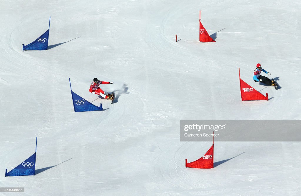 <a gi-track='captionPersonalityLinkClicked' href=/galleries/search?phrase=Simon+Schoch&family=editorial&specificpeople=869279 ng-click='$event.stopPropagation()'>Simon Schoch</a> of Switzerland and Zan Kosir of Slovenia compete in the Snowboard Men's Parallel Slalom Qualification on day 15 of the 2014 Winter Olympics at Rosa Khutor Extreme Park on February 22, 2014 in Sochi, Russia.