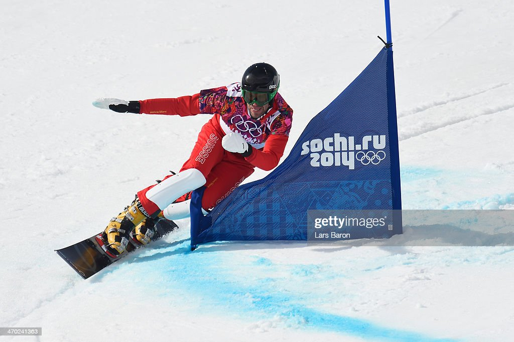 <a gi-track='captionPersonalityLinkClicked' href=/galleries/search?phrase=Simon+Schoch&family=editorial&specificpeople=869279 ng-click='$event.stopPropagation()'>Simon Schoch</a> of Switzerland competes in the Snowboard Men's Parallel Giant Slalom 1/8 finals on day twelve of the 2014 Winter Olympics at Rosa Khutor Extreme Park on February 19, 2014 in Sochi, Russia.