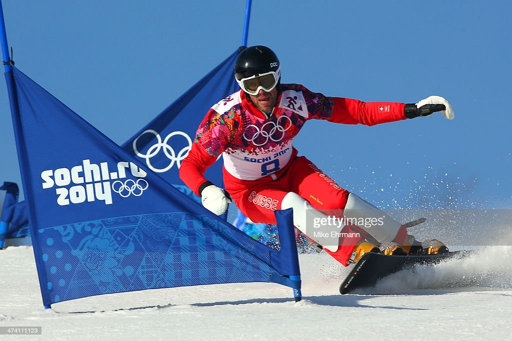 <a gi-track='captionPersonalityLinkClicked' href=/galleries/search?phrase=Simon+Schoch&family=editorial&specificpeople=869279 ng-click='$event.stopPropagation()'>Simon Schoch</a> of Switzerland competes in the Snowboard Men's Parallel Slalom Qualification on day 15 of the 2014 Winter Olympics at Rosa Khutor Extreme Park on February 22, 2014 in Sochi, Russia.
