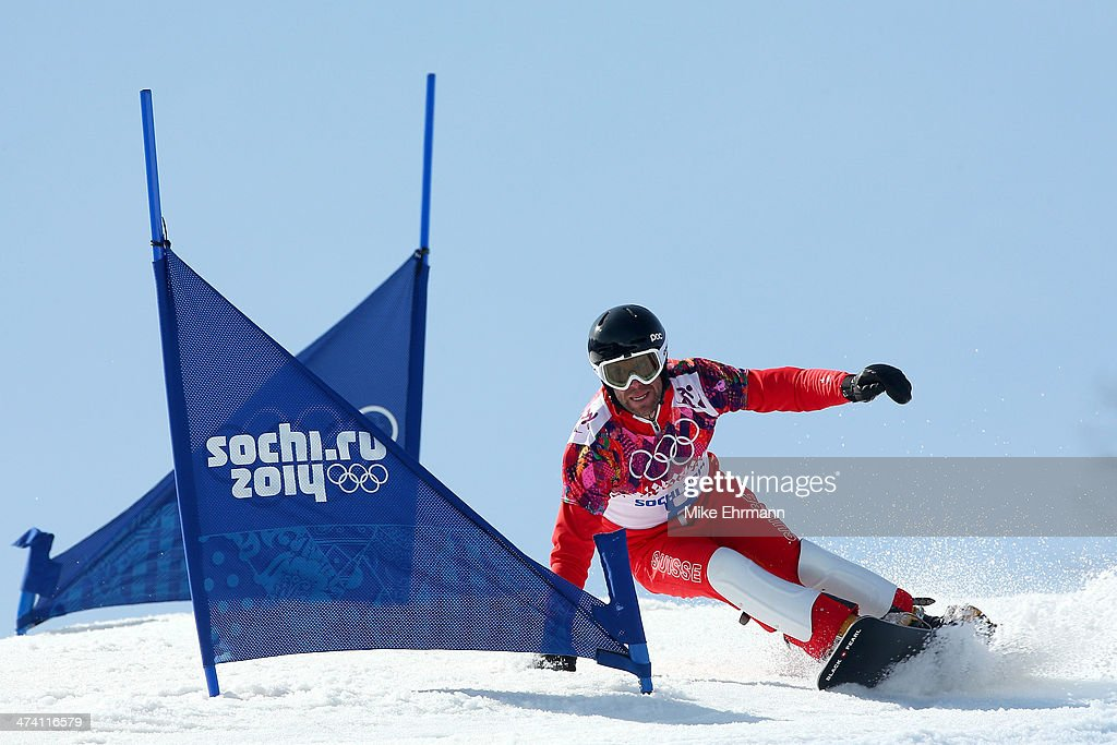 <a gi-track='captionPersonalityLinkClicked' href=/galleries/search?phrase=Simon+Schoch&family=editorial&specificpeople=869279 ng-click='$event.stopPropagation()'>Simon Schoch</a> of Switzerland competes in the Snowboard Men's Parallel Slalom 1/8 Finals on day 15 of the 2014 Winter Olympics at Rosa Khutor Extreme Park on February 22, 2014 in Sochi, Russia.