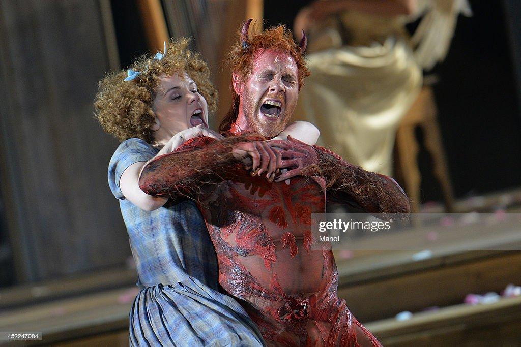 Simon Schwarz (Devil) and Sarah Viktoria Frick (Good Work) are seen during the photo rehearsal of 'Jedermann' (Everyman) on the Domplatz ahead of Salzburg Festival 2014 on July 16, 2014 in Salzburg, Austria.