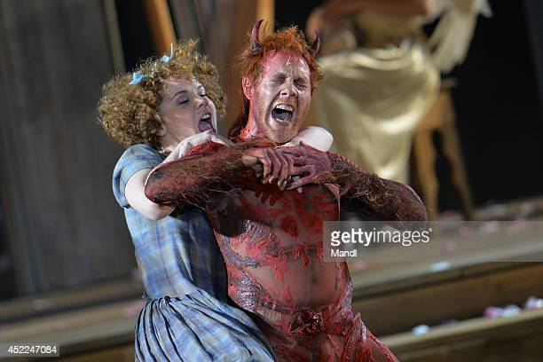 Simon Schwarz and Sarah Viktoria Frick are seen during the photo rehearsal of 'Jedermann' on the Domplatz ahead of Salzburg Festival 2014 on July 16...
