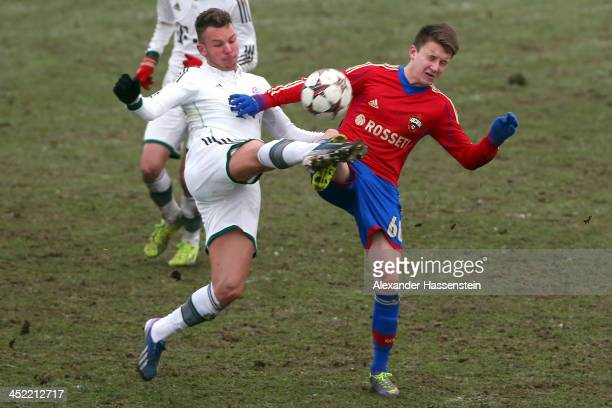 Simon Seferings of Bayern Muenchen battles for the ball with Aleksandr Golovin of Moscow during the UEFA Youth League match between CSKA Moscow and...