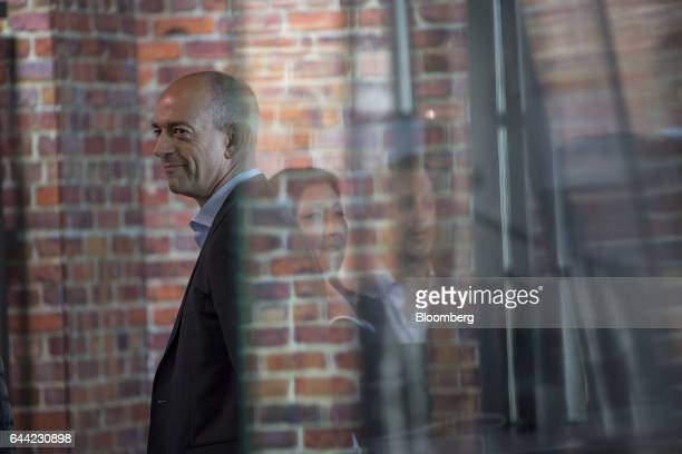 Simon Segars chief executive officer of ARM Holdings Plc watches from the green room prior to a Bloomberg Technology television interview in San...