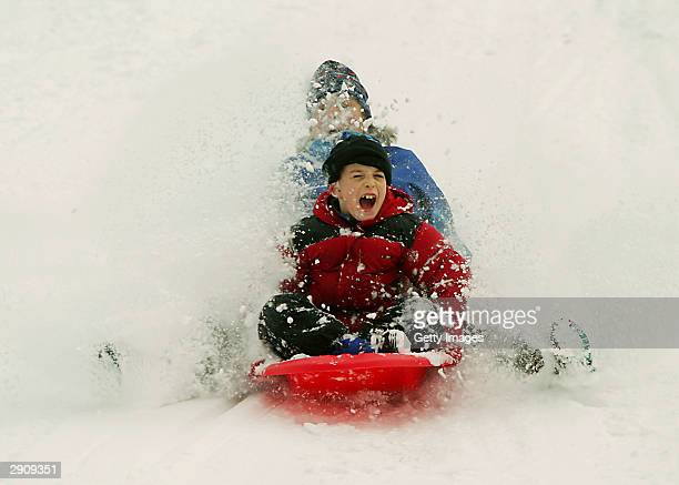 Simon Sharpe and his mother Corrinne Collett both of CrotononHudson New York ride a sled together at the Croton Gorge Dam Park January 28 2004 in...