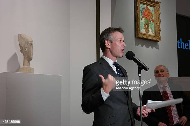 Simon Shaw CoHead Impressionist Modern Art Worldwide of Sotheby's speaks during an auction in which Alberto Giacometti's Chariot sold for $101 and...